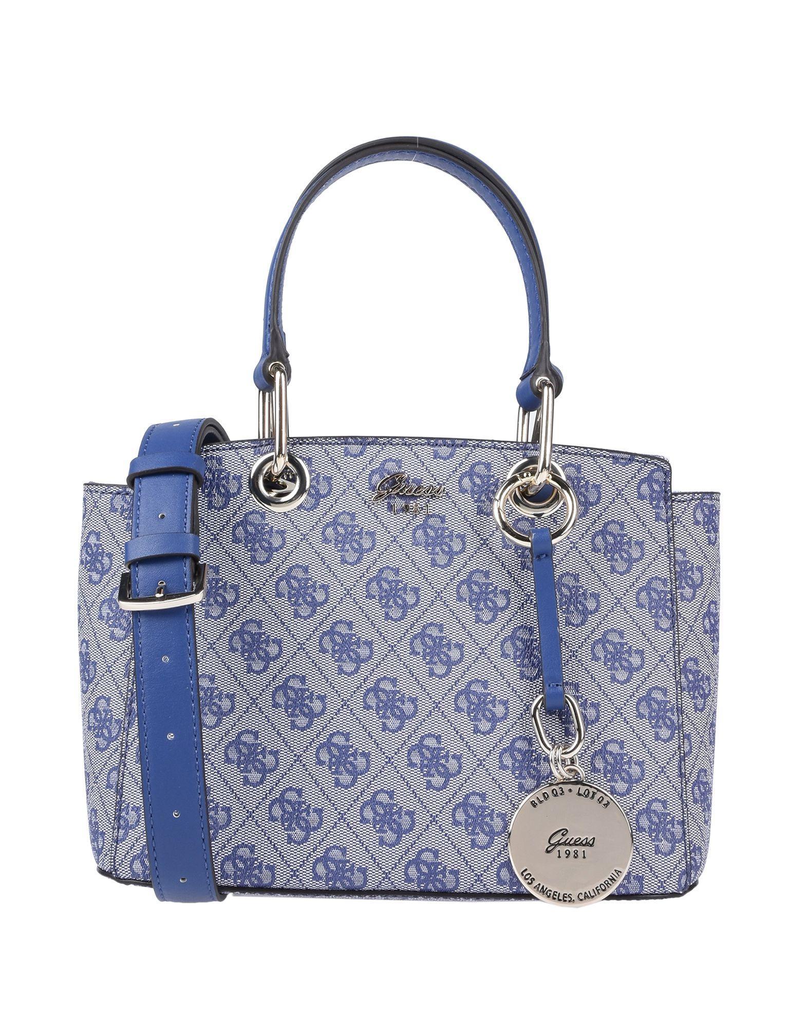 44a89126ea19 Женские сумки синего цвета Guess купить в интернет магазине ...